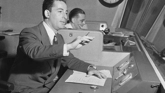 """Radio producer Himan Brown works in a CBS radio studio in New York in 1943. Brown put the bulk of his $100 million estate into a charitable trust controlled by his longtime lawyer. A lawsuit claims the attorney uses the money """"for his personal benefit, in disregard of the express intent of Brown's will and prior estate plan."""""""