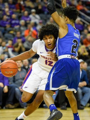 University of Evansville's Dru Smith (12) drives the baseline against Indiana State's Jordan Barnes (2) as the University's of Evansville Purple Aces play the Indiana State Sycamores at the Ford Center Wednesday, January 17, 2018.