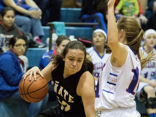 Oñate's Deanna Lopez drives against LCHS's Nakona Drake.
