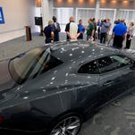 A 2016 Camaro is the star of the show as GM announces plans Thursday  morning 5/28/2015 to resume a second shift of workers to build the Camaro at the GM Lansing Grand River plant.