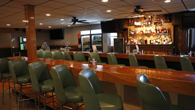 Two rows of stools line the bar at Stephenson Mill Tavern & Grill in Walton.