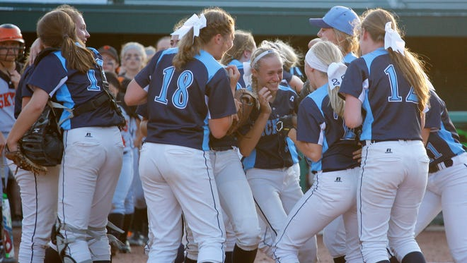 Richmond players celebrate their 6-2 win over Escanaba in their MHSAA semifinal game Thursday, June 16, 2016, at Michigan State University in East Lansing.