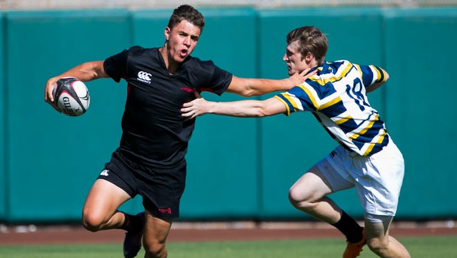 Red Mountain's Kaden Connelly stiff arms Desert Vista's Cameron Diamond during the Fiesta Bowl Rugby Classic at Scottsdale Stadium on April 23, 2016 in Scottsdale, Ariz.