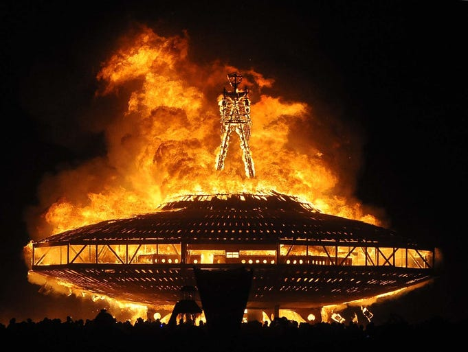 "The ""Man"" burns on the Black Rock Desert at Burning Man near Gerlach, Nev. late on August 31. U.S. Bureau of Land Management spokesman Mark Turney said  more than 61,000 people turned out for the weekend Burning Man outdoor art and music festival."