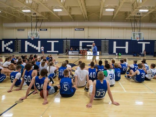 Tim Weidenbach, assistant basketball coach at O'Gorman