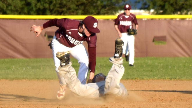 Stuarts Draft's Dalton McGann tags out on Waynesboro's Austin Truslow at second base on a steal attempt during the third inning of their nondistrict game on Monday, April 10, 2017, at Stuarts Draft High School. The Cougars won 6-1.