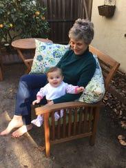 Jane Szalkowski holds her 6-month old granddaughter,