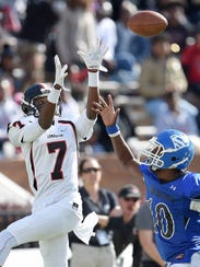 Lumberton's Donnell Buckner (7) goes up for a pass