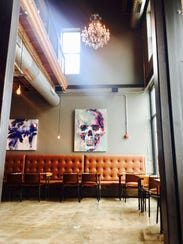 The dining room at Taxman Brasserie and Tap Room in Fortville.