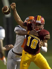 Laurel quarterback Xavier Evans (10) loses the ball