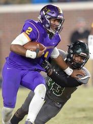 Hattiesburg quarterback Snoop Conner (2) stiff arms
