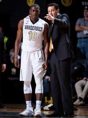 Vanderbilt coach Bryce Drew speaks with guard Maxwell Evans (10) during the first half against Alabama on Jan. 2.