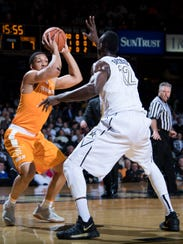 Tennessee forward Grant Williams (2) shoots over Vanderbilt