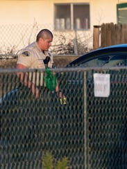 Tulare County sheriffÕs deputies investigate a shooting at Camp Drive and Wills Avenue in Goshen on Wednesday, January 10, 2018. One person was transported to the hospital from the scene.