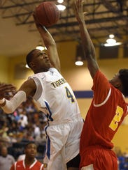 Canton's Brandon Weatherspoon (4) tries to dunk against
