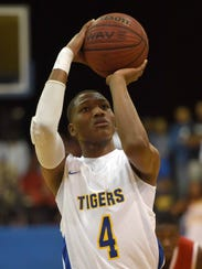 Canton's Brandon Weatherspoon (4) shoots against Holmes