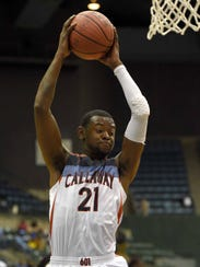 Callaway's Deonte' Spencer (21) rebounds against Stone