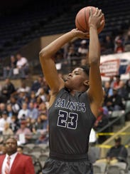 St. Andrew's Garrison Wade (23) shoots a jumper against