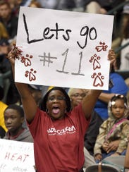 A Lawrence County fan cheers for the Lady Cougars in