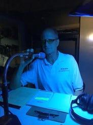 Actor Stephen Hooper with the audio-description equipment