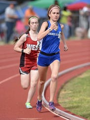 Vancleave's Lina May leads the Class 4A 1600 meters, her second of three distance races on Friday, May 4, 2018, in the MHSAA Class 2A-4A-6A State Track & Field Meet at Pearl High School in Pearl, Miss.
