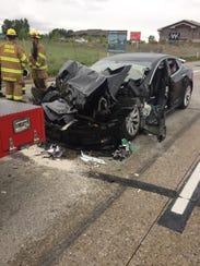 A Tesla sedan with a semi-autonomous Autopilot feature