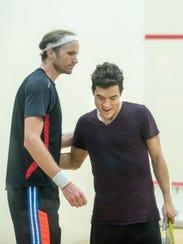 Squash player Stephen Coppinger (left) congratulates