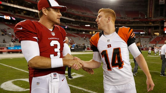 Cardinals quarterback Carson Palmer and Bengals quarterback Andy Dalton get together after their preseason game Sunday night at University of Phoenix Stadium.