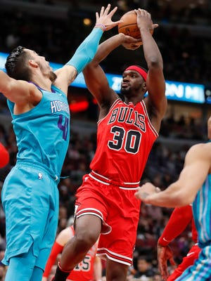 Apr 3, 2018; Chicago, IL, USA; Chicago Bulls forward Noah Vonleh (30) shoots against Charlotte Hornets center Willy Hernangomez (41) during the first half at United Center. Mandatory Credit: Kamil Krzaczynski-USA TODAY Sports