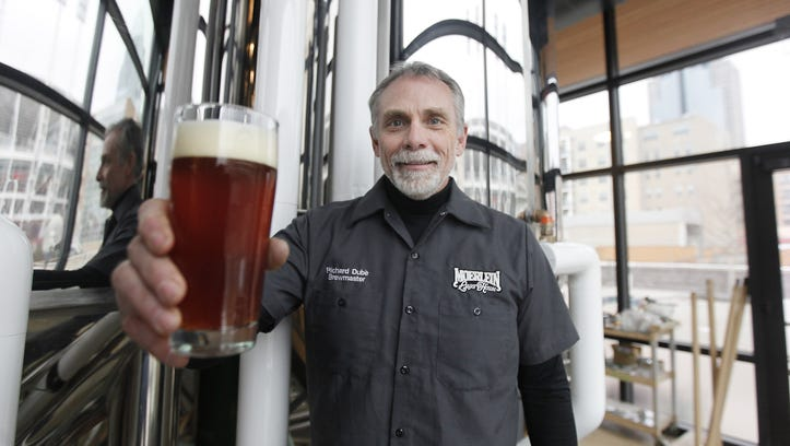 Richard Dube holds a glass of beer at the Moerlein Lager House.