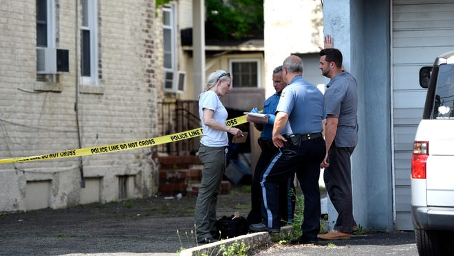 Totowa police officers and the crime scene unit seen outside of 340 Totowa road, which according to a neighbor has been abandoned for years, on Tuesday, May 15, 2018.
