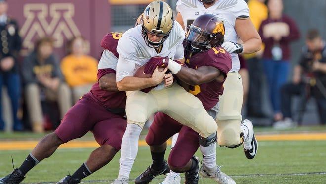 Minnesota linebacker Jonathan Celestin (13) sacks Purdue quarterback David Blough (11) in the first half at TCF Bank Stadium.
