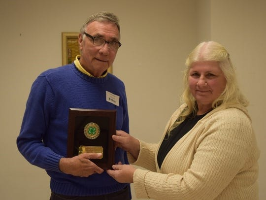 Sherry Helmer presents Bill McCollum with the Friends