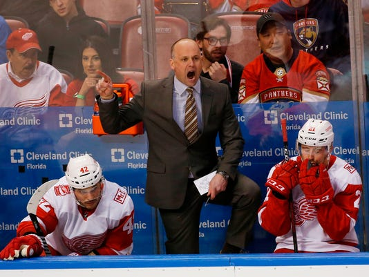 FILE - In this Feb. 3, 2018, file photo, Detroit Red Wings head coach Jeff Blashill argues a call during the third period of an NHL hockey game against the Florida Panthers, in Sunrise, Fla. The Red Wings are bringing coach Jeff Blashill for a fourth season. Red Wings general manager Ken Holland announced the decision on Tuesday, April 10, 2018, saying the team played hard for Blashill until the end of the season. (AP Photo/Wilfredo Lee, File)