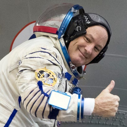 U.S. astronaut Scott Tingle give the thumbs up after