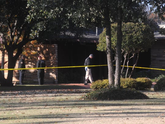 Abilene forensic unit officers prepare to investigate the scene of a fatal shooting in the 3700th block of Woodridge Drive Monday, Dec. 12, 2016. Realtor Thomas Niblo was shot multiple times inside his residence.