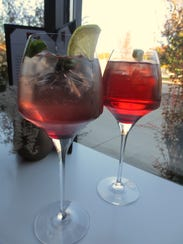 The Le Jardin blackberry mint spritzer, left, and New