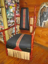 A fringed chair made with recycled leather from old