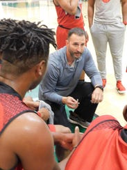 Port Barre basketball coach Andy Aymond talks to his