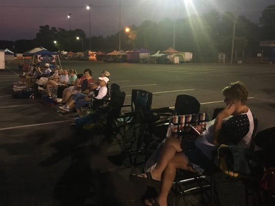 """People were already lined up by 5 a.m. on Wednesday for the """"Chair Dash."""""""