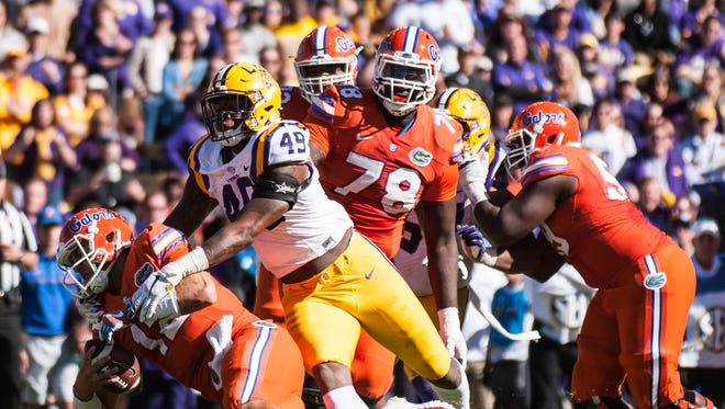 LSU Tigers defensive end Arden Key (49) with the tackle for a Florida loss in Death Valley, November 19, 2016.