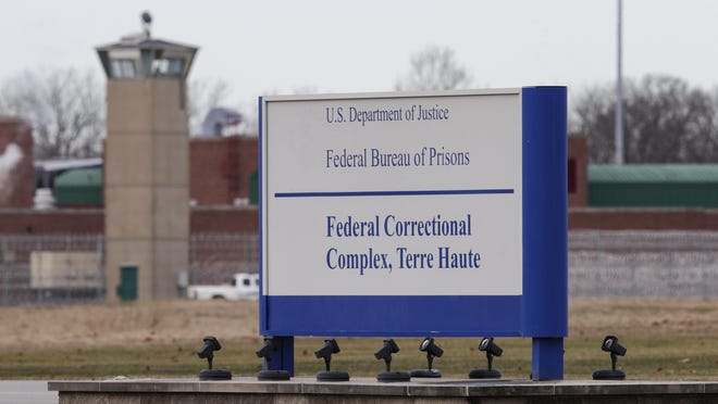 The guard tower flanks the sign at the entrance to the U.S. Penitentiary in Terre Haute, Ind. The facility houses a Special Confinement Unit for male federal inmates who have been sentenced to death as well as the federal execution chamber.