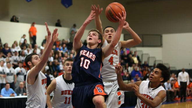 Briarcliff's Jack Reish (10) is surrounded by Marlboro defenders as he goes up for a shot during first half action in the boys basketball regional semifinal at Mount Saint Mary College in Newburgh March 2, 2016. Marlboro won the game 57-49.