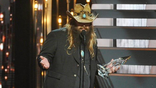 Chris Stapleton holds his New Artist of the Year award at the 49th annual CMA Awards at Bridgestone Arena on Wednesday in Nashville.