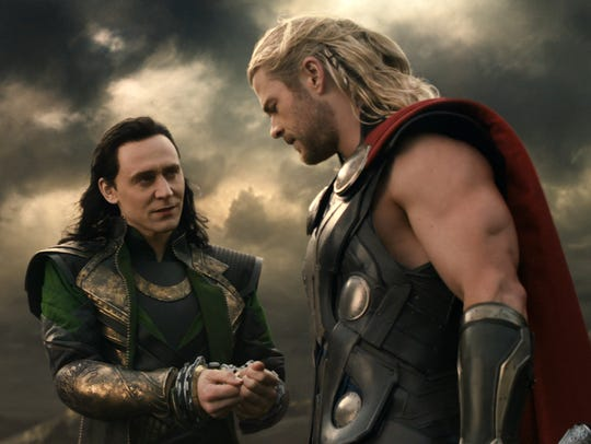 Chris Hemsworth as Thor, right, with his brother Loki, played by Tom Hiddleston.
