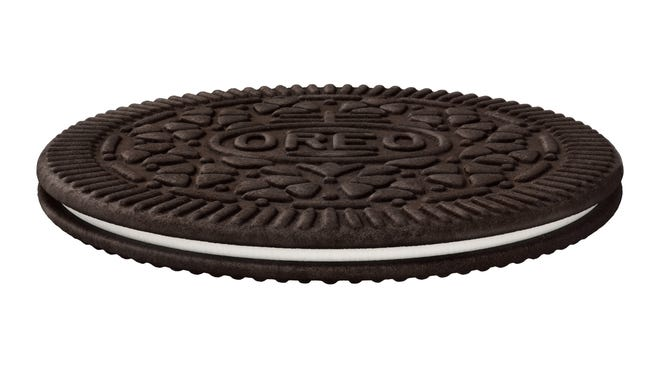 """This product image provided by Mondelez shows an """"Oreo Thin"""". Mondelez International Inc. says it will add """"Oreo Thins,"""" which have a similar cookie-to-filling ratio as regular Oreos, except that they're slimmer, to its permanent lineup in the U.S. starting next week. (Mondelez via AP)"""