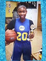 Na'imah McDonald in her basketball uniform.