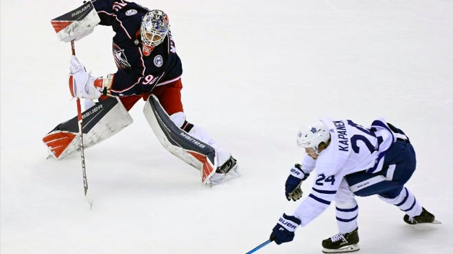 Goalie Elvis Merzlikins (90) will make his first playoff start in the NHL for the Blue Jackets on Friday against the Maple Leafs. Merzlikins earned a 21-save win in a relief role in Game 3 Thursday in Toronto.