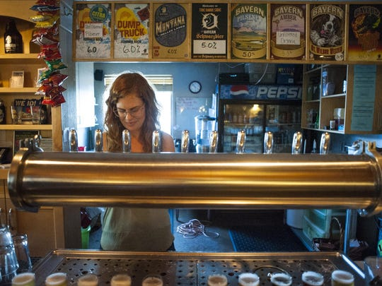 Trisha Peters pours two flights at Missoula's Bayern Brewing, the oldest brewery in Montana.