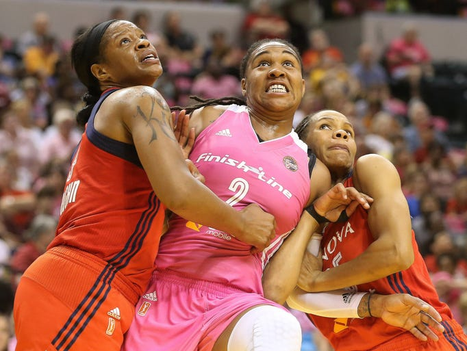 Erlana Larkins of the Fever battles Mystics players Kia Vaughn and Monique Currie for rebounding position under the basket. The Indiana Fever hosted the Washington Mystics in WNBA action Friday August 8, 2014 at Bankers Life Fieldhouse in Indianapolis.